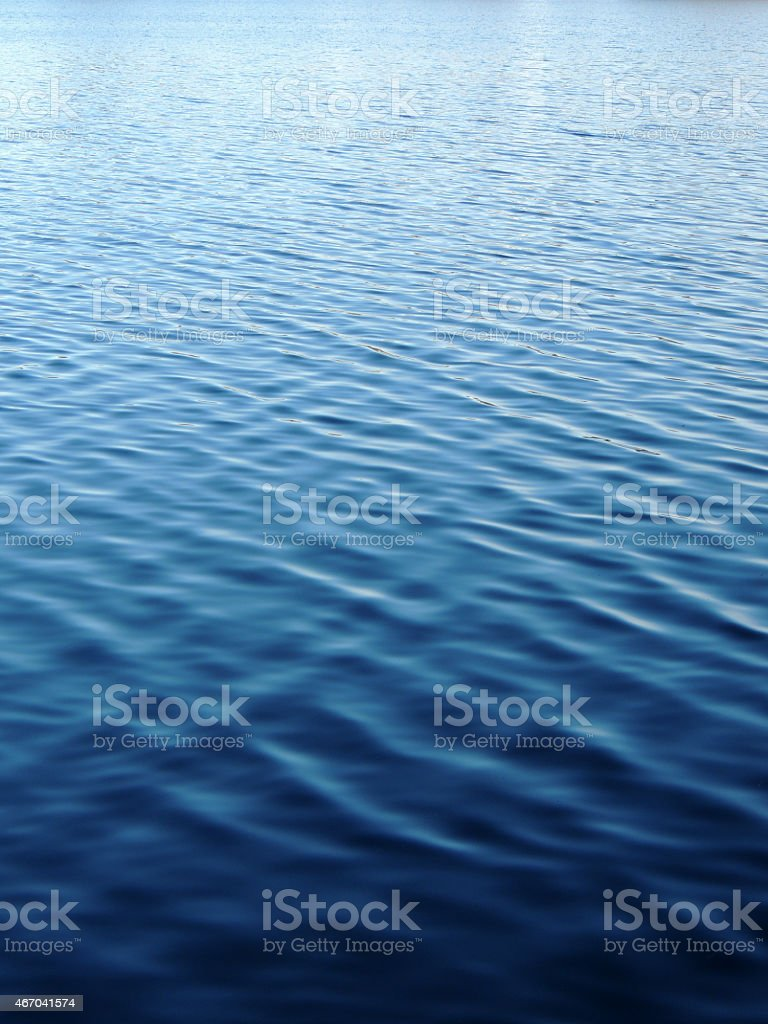 Gently rippling waves receding into background stock photo