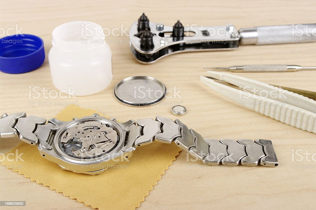 Gents Wristwatch With Back Removed And Tools For Battery Change stock photo