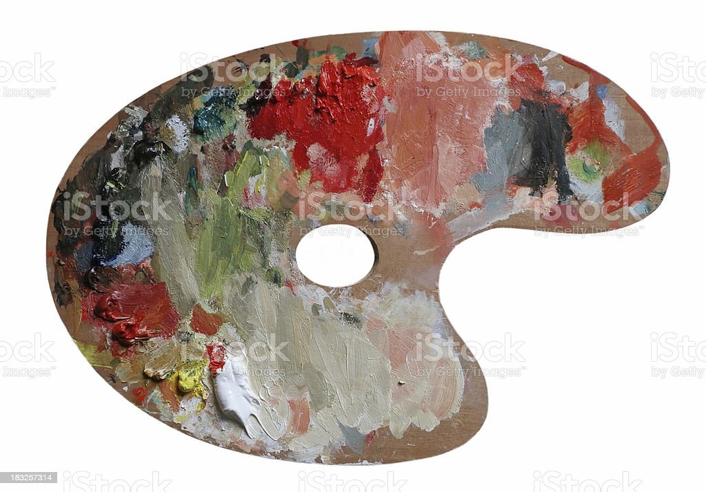 Genuine Palette of wood with oil paint. stock photo