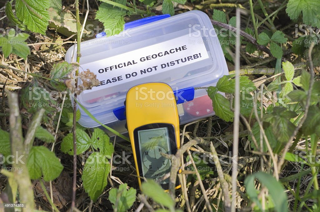 Geocache and GPS Device stock photo