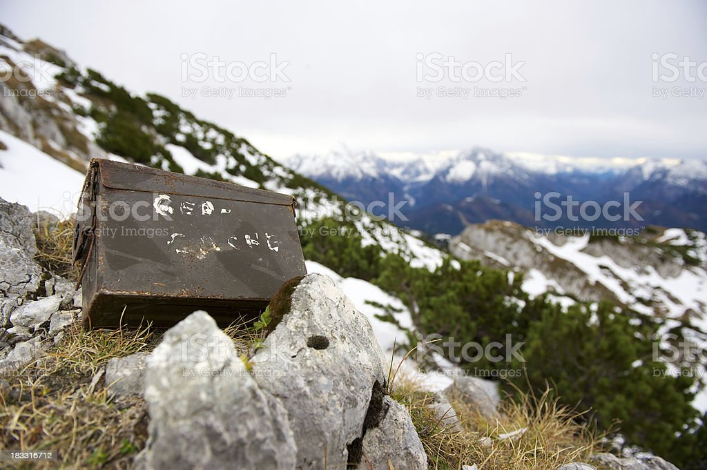 Geocache in the mountains stock photo