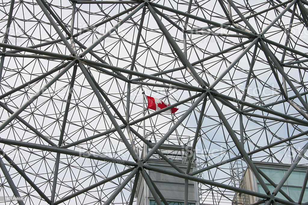 Geodesic dome structure and Canadian flag royalty-free stock photo