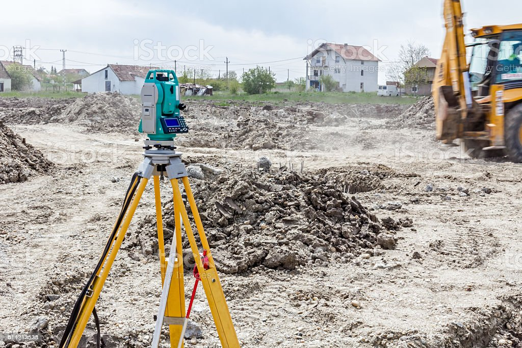 Geodesist device on a building site. Civil engineer with theodol stock photo