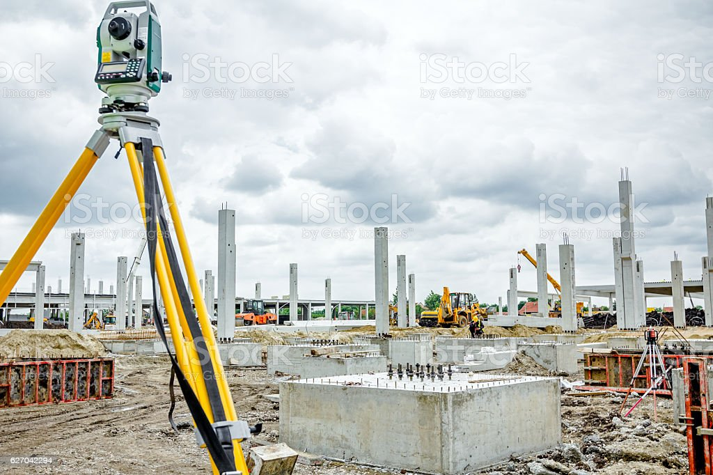 Geodesist device on tripod is connected with total station. stock photo