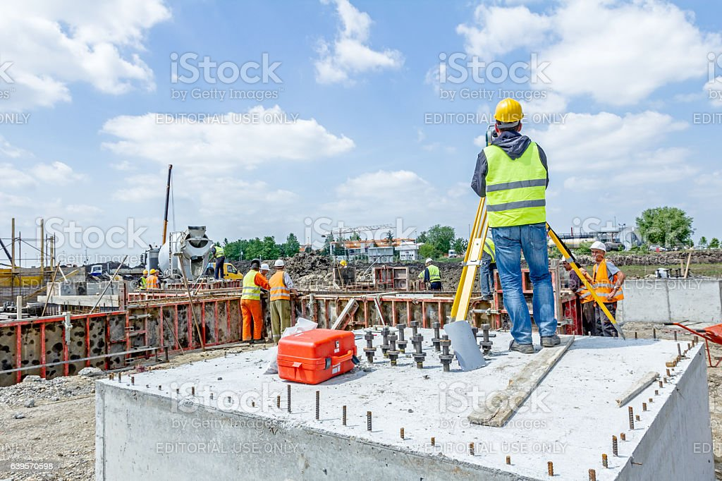 Geodesist is working with total station on a building site. stock photo