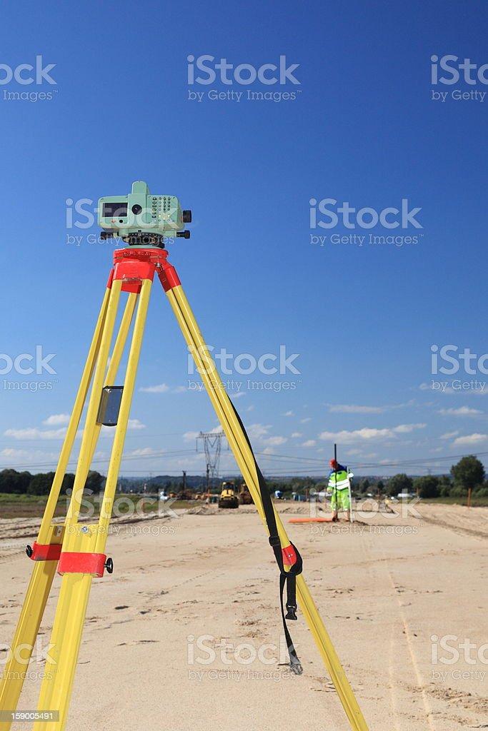geodesist taking measurement royalty-free stock photo