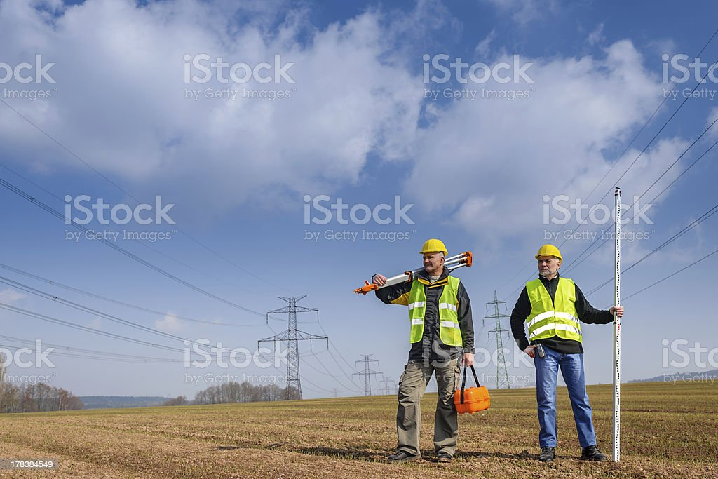 Geodesist two man equipment on construction site stock photo