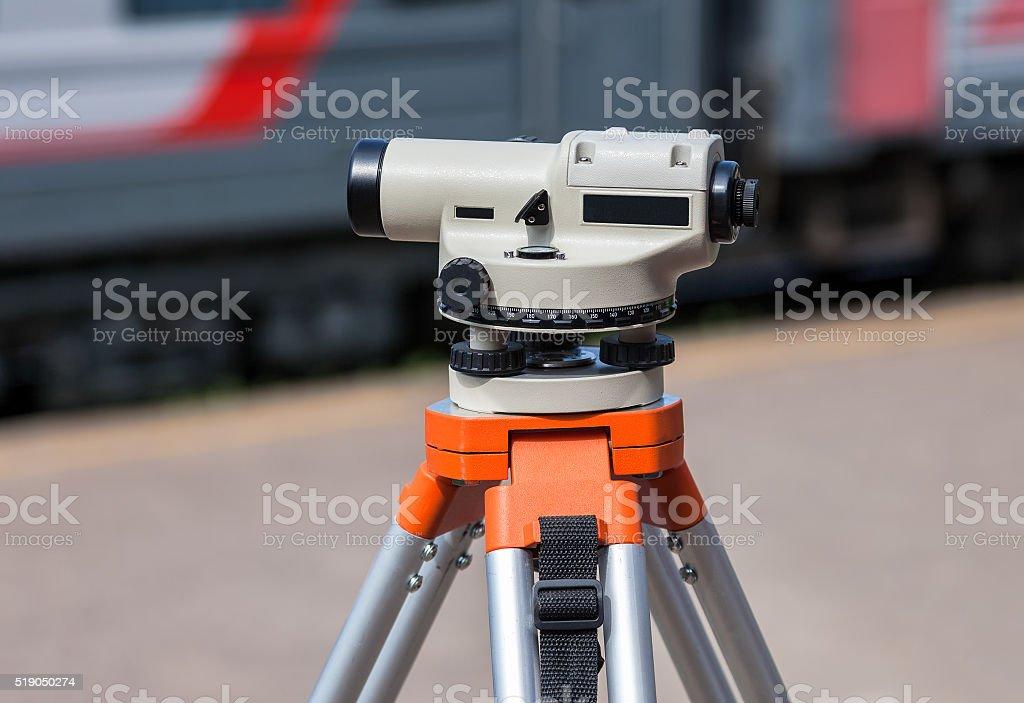 Geodetic equipment optical level mounted on tripod stock photo