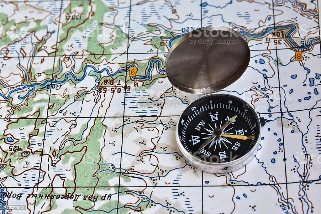 Geographical map and a compass. stock photo