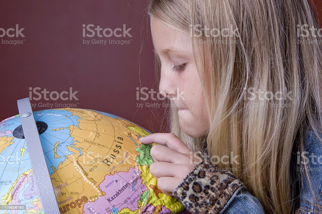Geography Lesson with Globe royalty-free stock photo