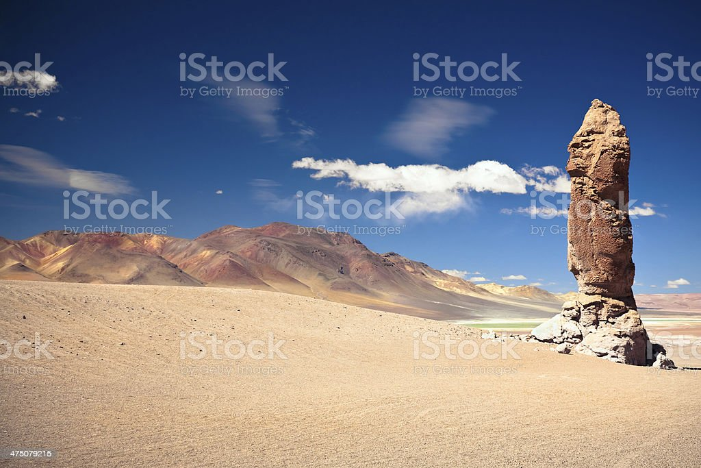 geological monolith close to Salar Aguas Calientes and Cerro Losloyo royalty-free stock photo