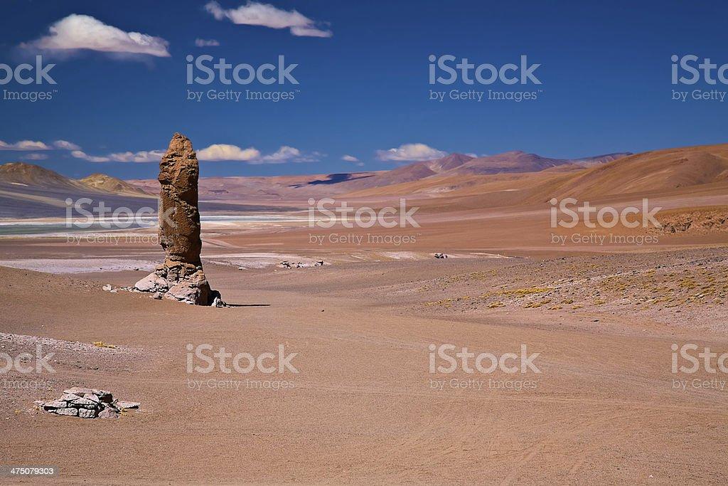 geological monolith close to Salar Aguas Calientes and Cerro Losloyo royalty-free stock photo