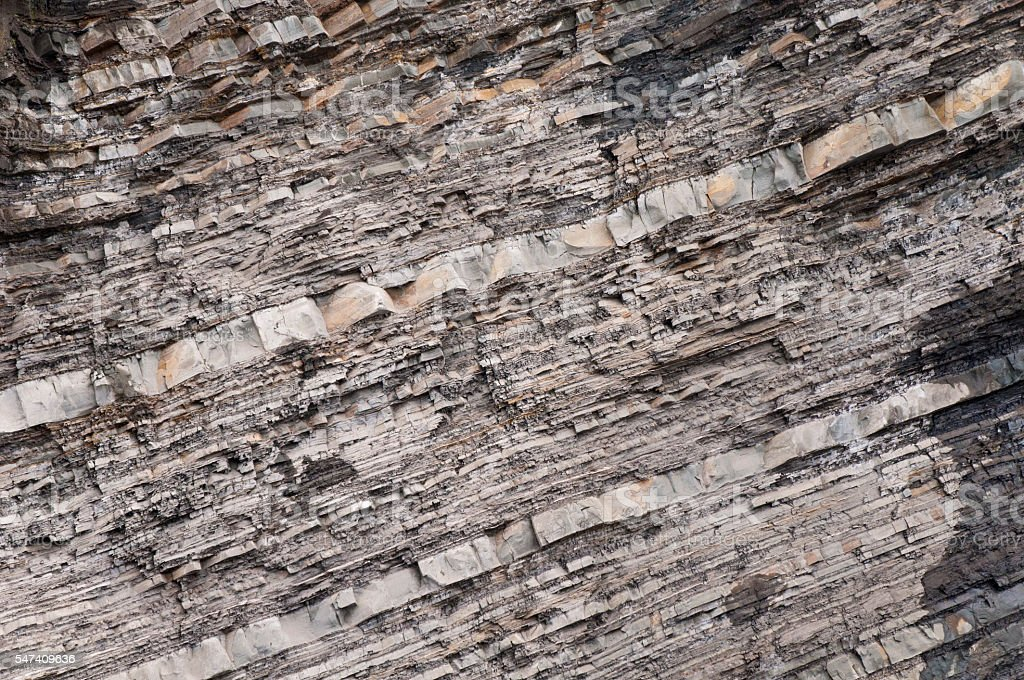 Geological rock layer on the hill in Tbilisi stock photo