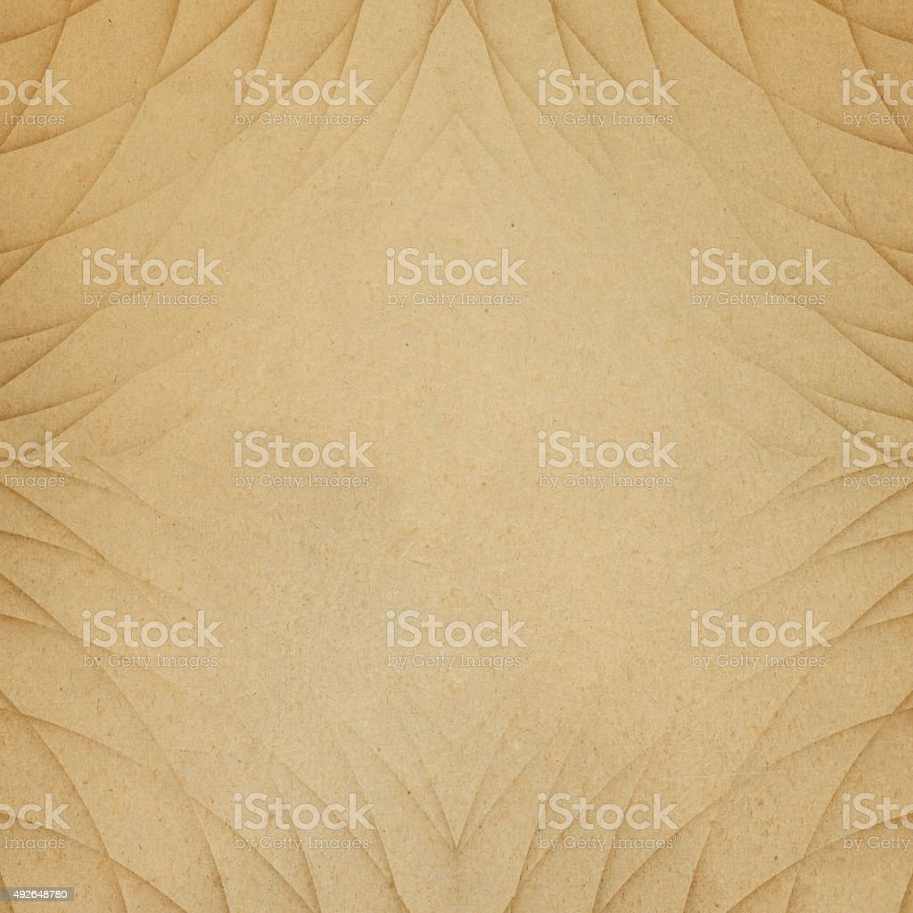 Geometric design on brown worn paper stock photo
