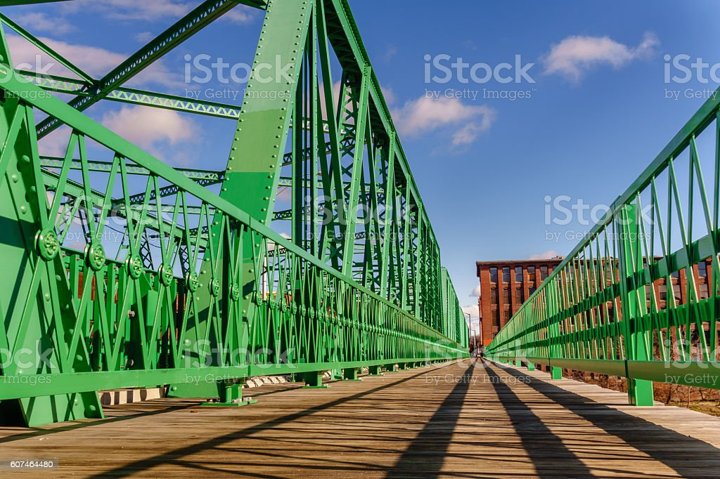 geometric lines on bridge in mill town stock photo