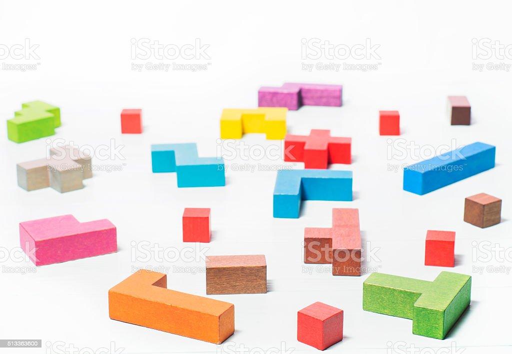 Geometric shapes, tetris toy wooden blocks. Logical thinking stock photo