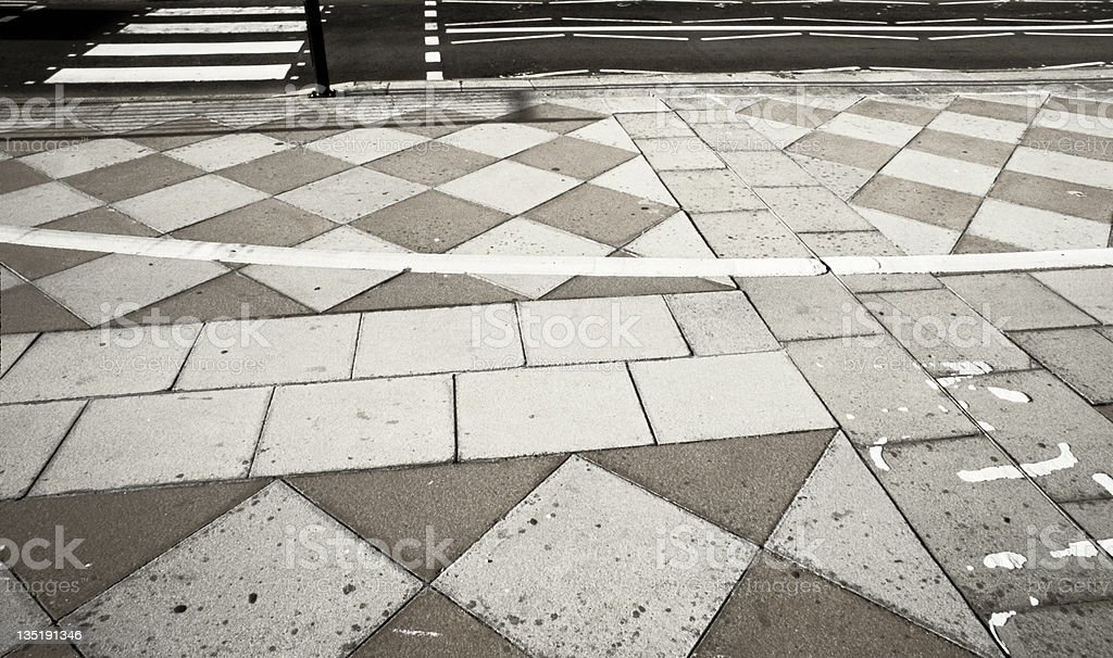 Geometrical, abstract patterns on the pavement and the tarmac stock photo