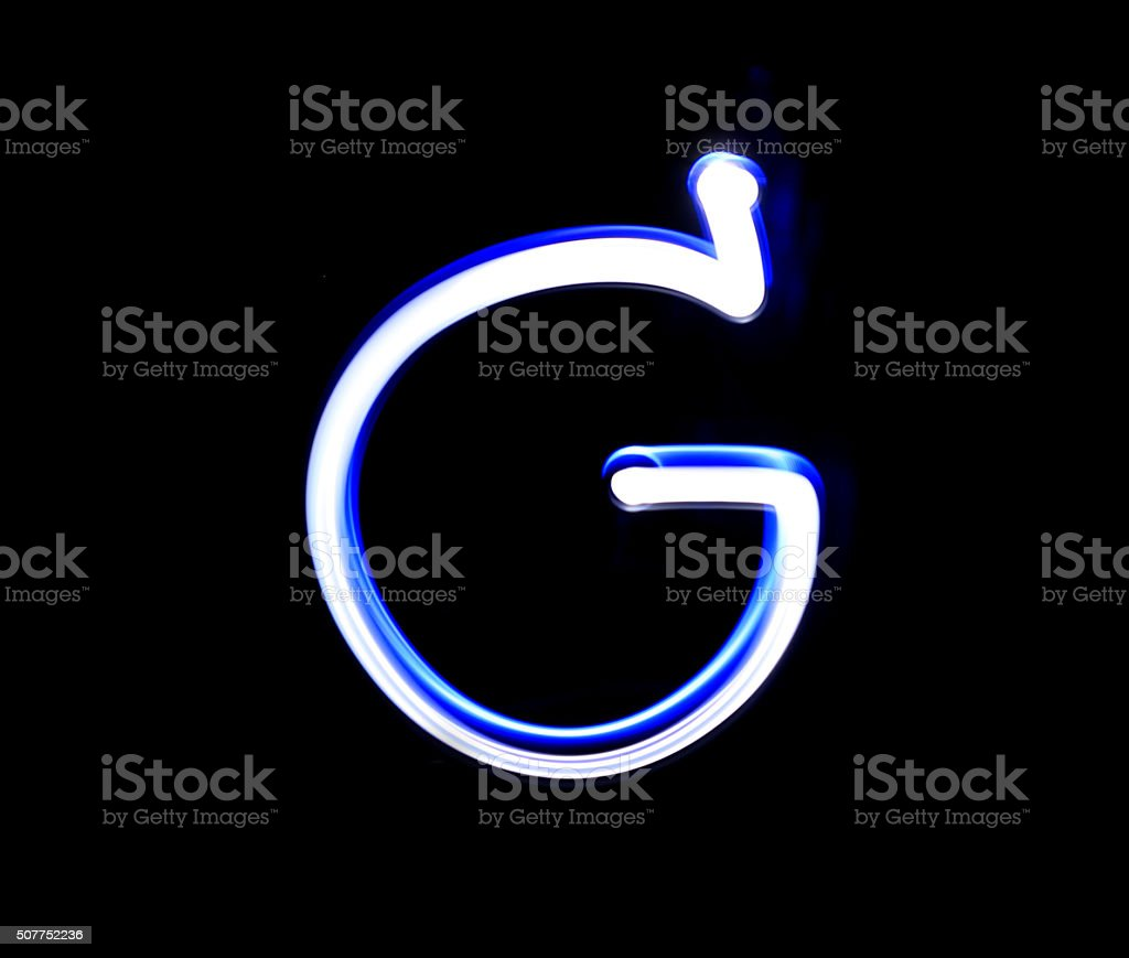 G George alphabet hand writing blue light  over black background stock photo