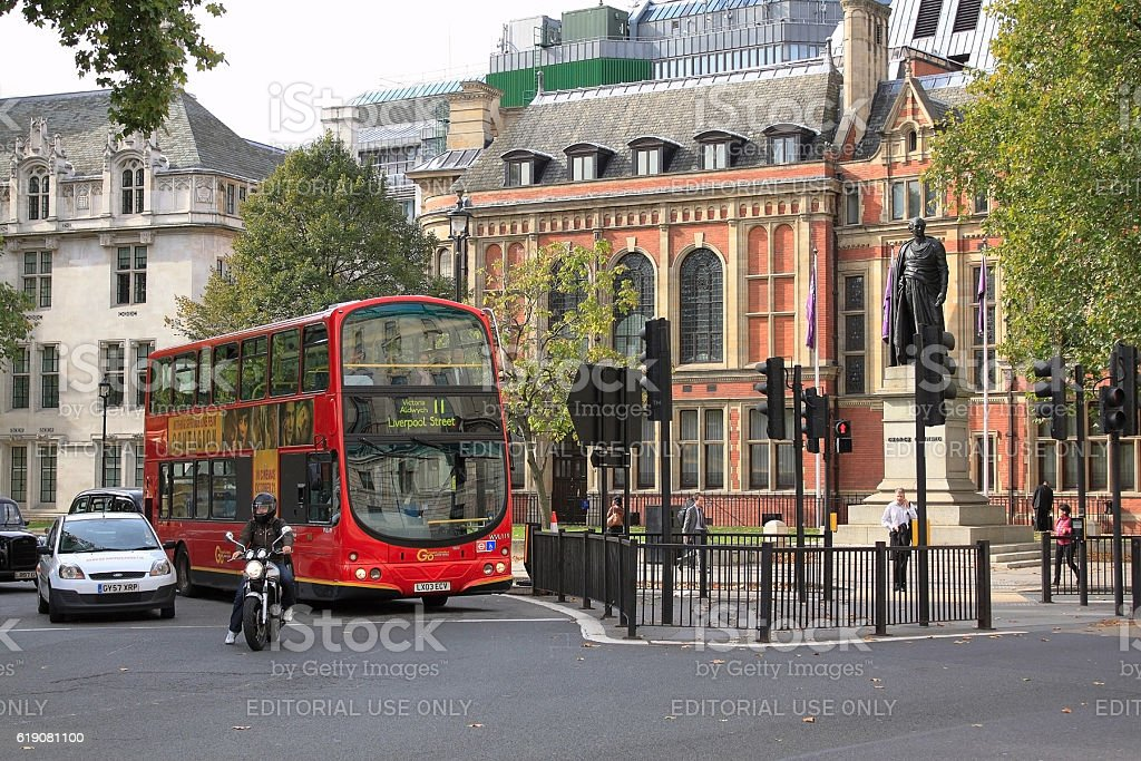 George Canning statue,  London red double-decker bus  in Parliament Square in London stock photo