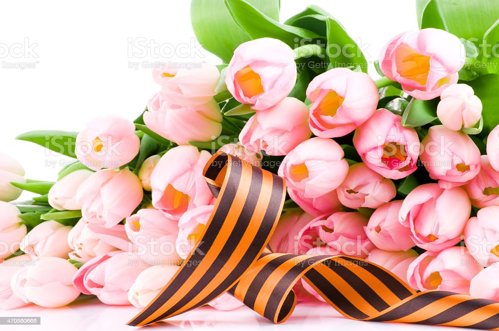 George ribbon and pink tulips stock photo