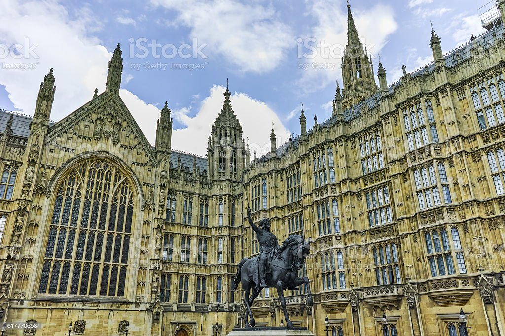 George V monument and Westminster Abbey, London, England stock photo