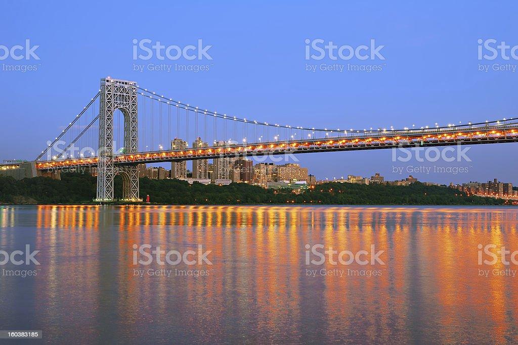 George Washington Bridge with NYC skyline at dusk royalty-free stock photo