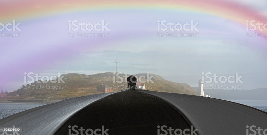 Georges Island in Halifax harbor with umbrella and rainbow stock photo