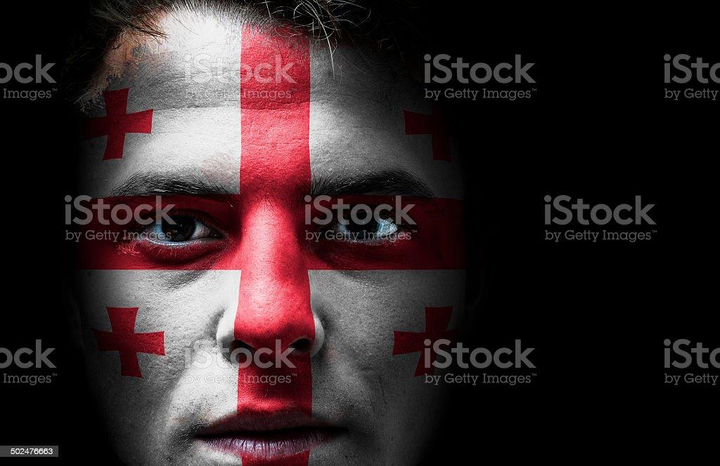 Georgia, Georgian flag on face stock photo