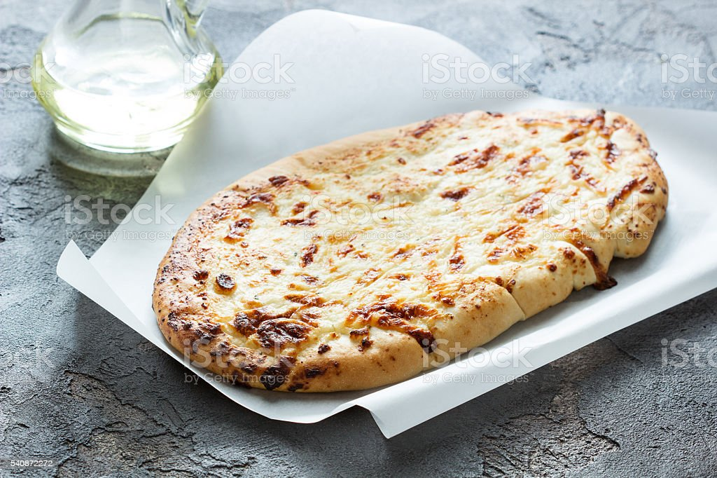 Georgian bread with cheese  with olive oil stock photo