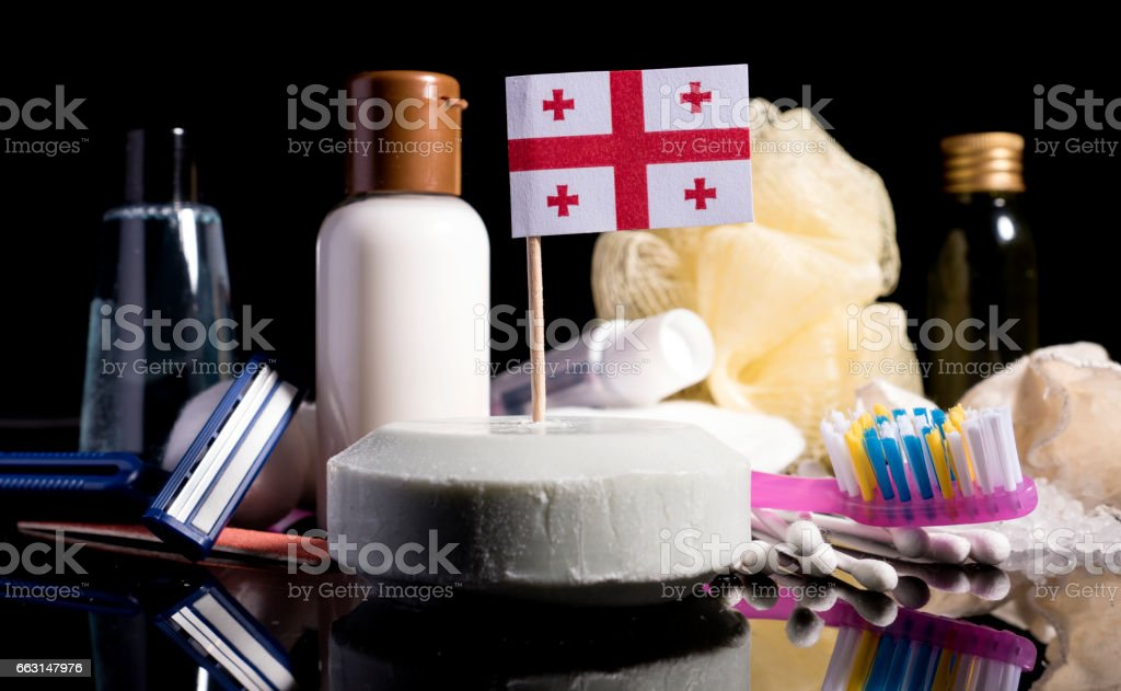 Georgian flag in the soap with all the products for the people hygiene stock photo