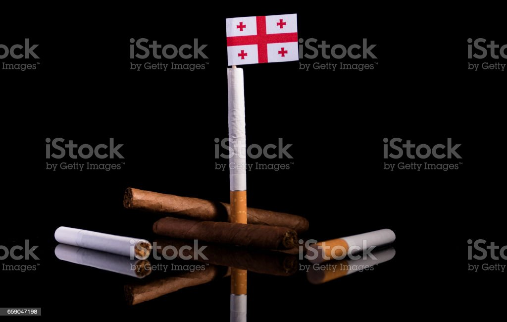 Georgian flag with cigarettes and cigars. Tobacco Industry concept. stock photo