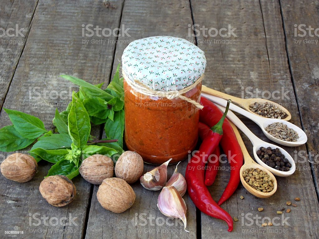 Georgian home adjika sauce of pepper, garlic, walnuts stock photo