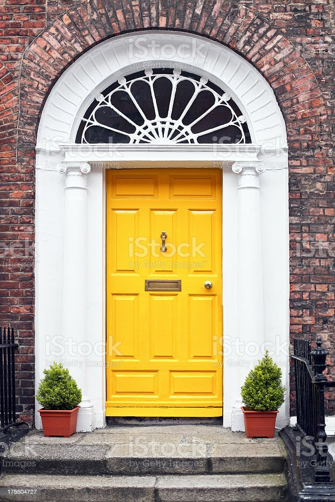 Georgian style yellow wooden door stock photo