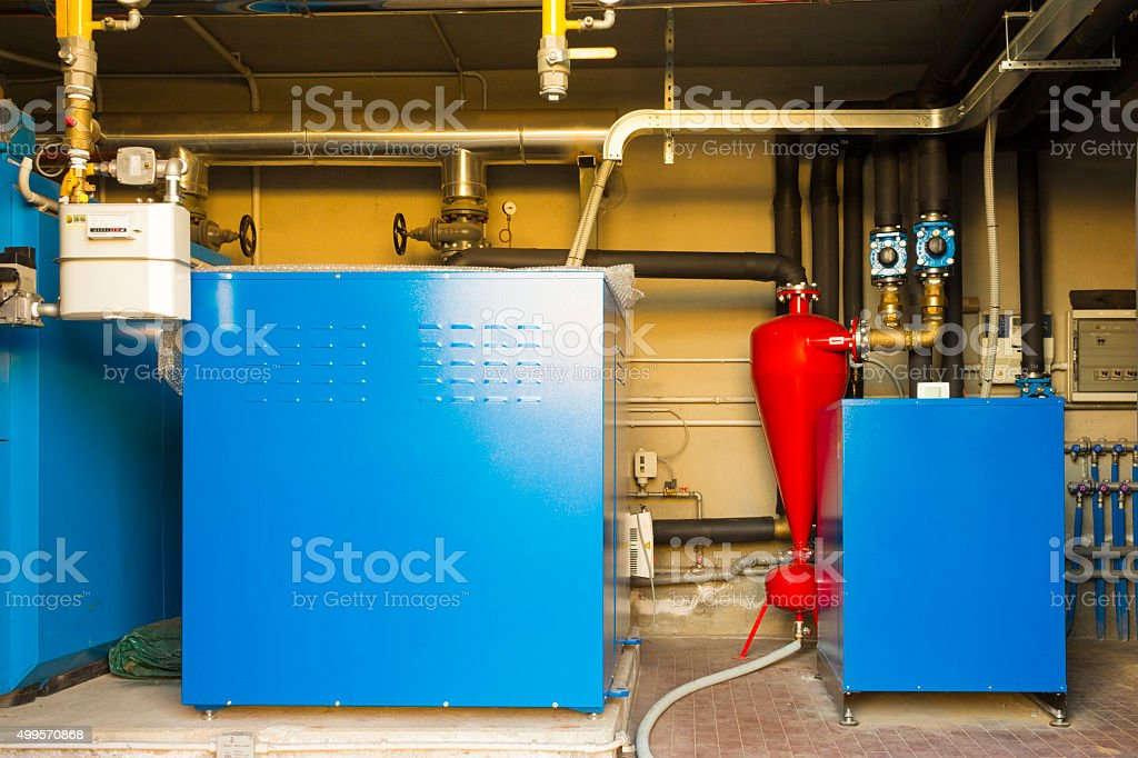 Geothermal heat pump for heating in the boiler room stock photo