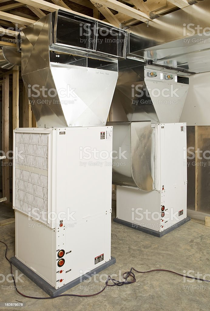 Geothermal Heating/Air Conditioning Units Installed in a new home stock photo