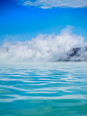 geothermal lake  in Iceland with steam