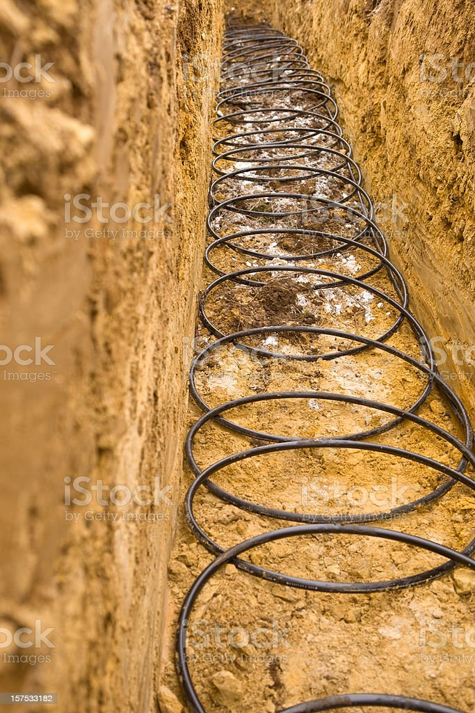 Geothermal Pipe at the bottom of a Trench stock photo
