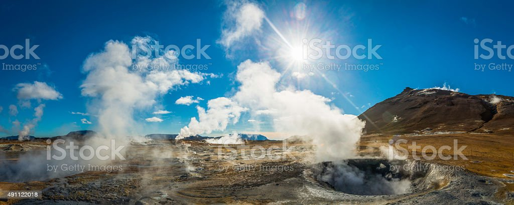 Geothermal steam rising over hot springs volcano panorama Hverir Iceland stock photo