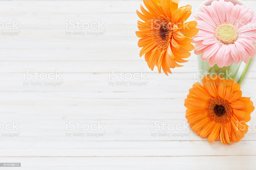 gerbera flowers on the wooden table stock photo
