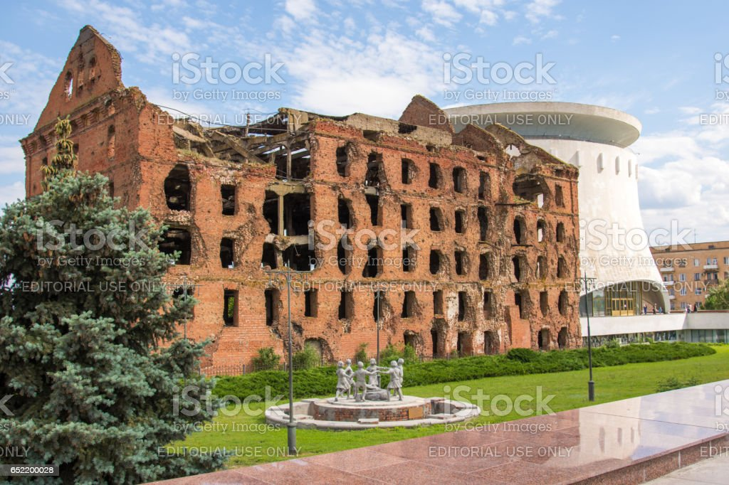 Volgograd. Russia - June 11, 2016. Gerhardt Destroyed mill and a copy of the monument Fountain 'Barmaley' next to the mill in Volgograd Memorial Museum-panorama 'The Battle of Stalingrad' stock photo