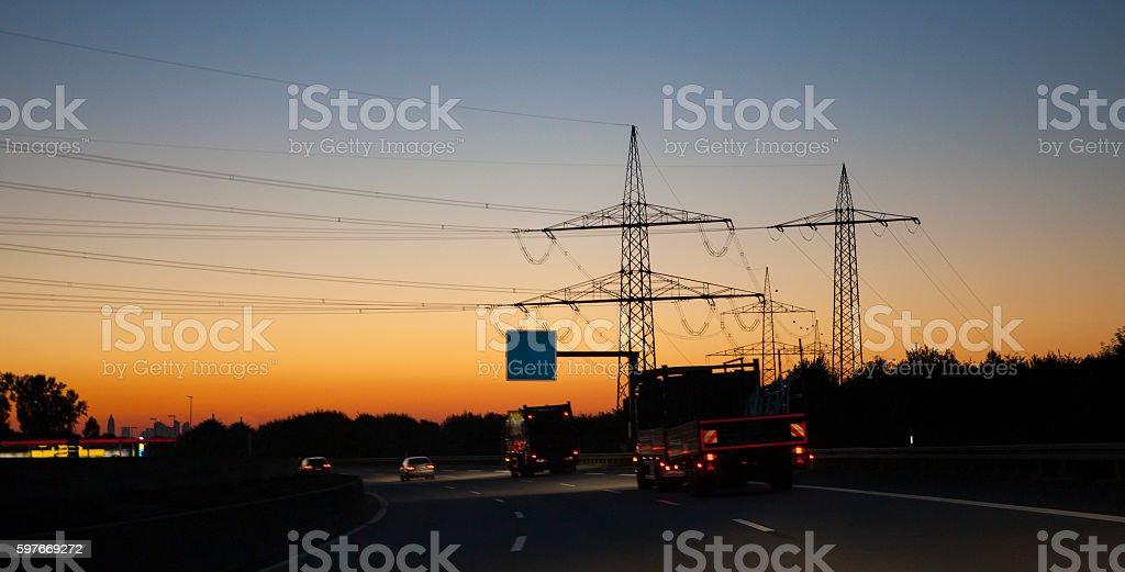 German autobahn electricity pylon dawn sunset morning stock photo