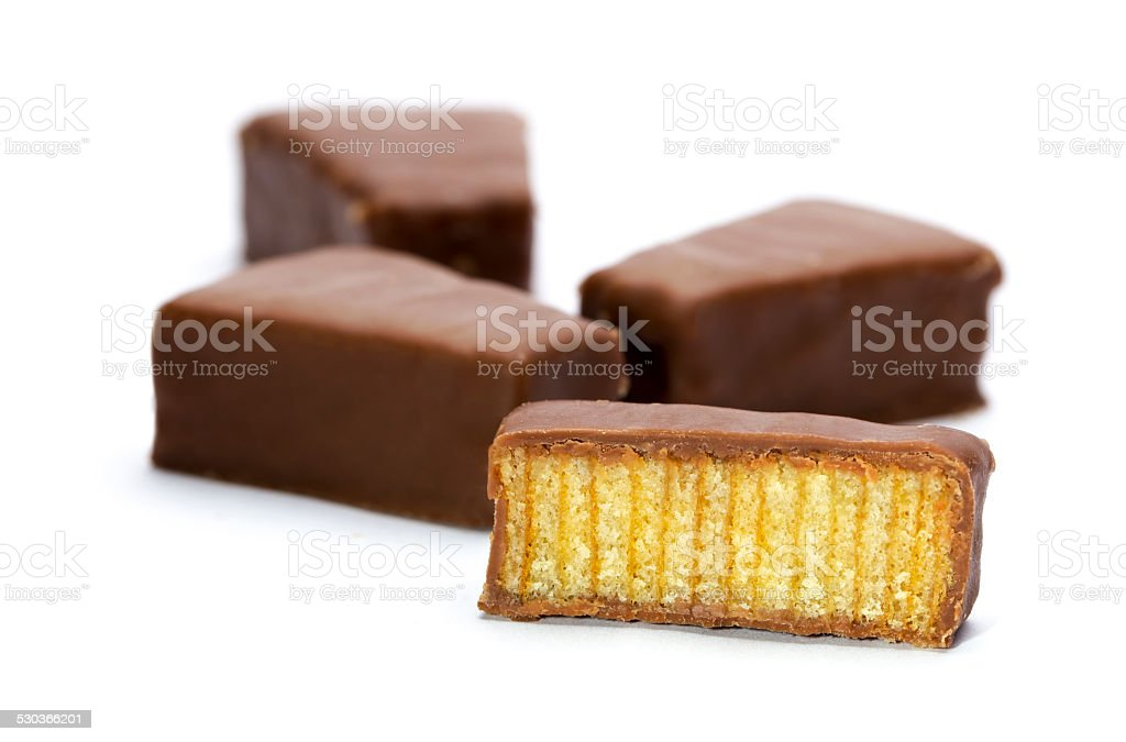 German Baumkuchen pieces isolated on white stock photo