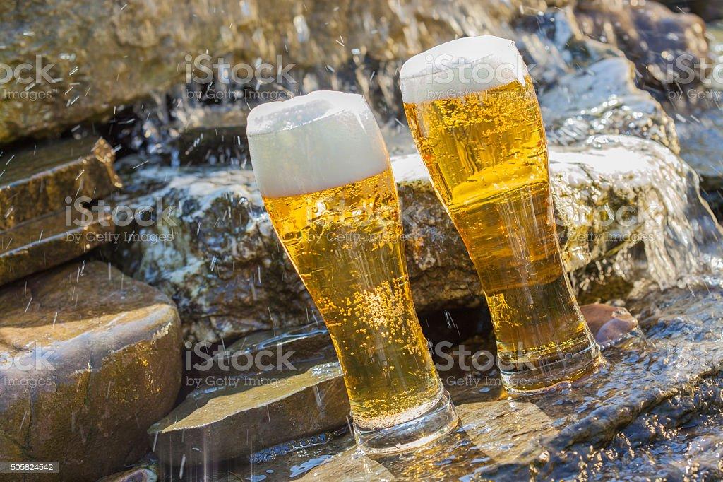 german beer cooled in waterfall stock photo