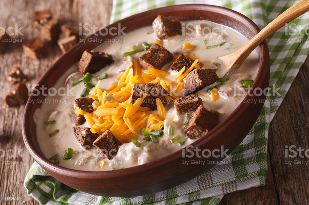 German beer soup with cheese and croutons in bowl close-up stock photo