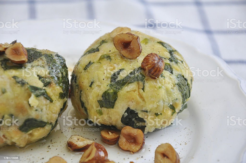 German boiled bread dumpling with spinach and hazelnut butter royalty-free stock photo