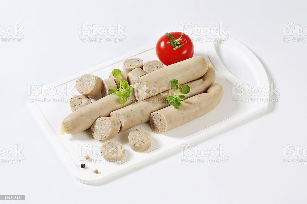 German bratwurst on a white cutting board royalty-free stock photo
