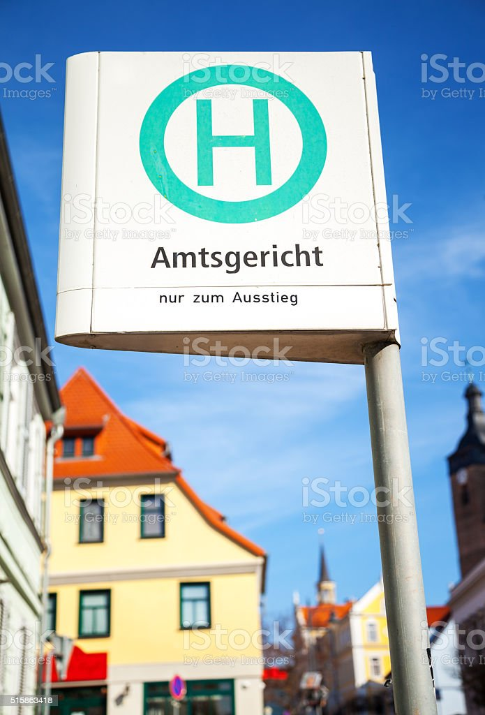 german bus stop sign in a city on Amtsgericht stock photo