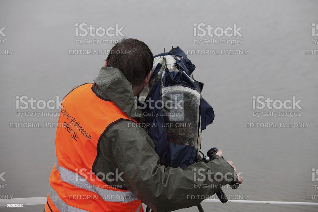 German cameraman at Duhner wadden race stock photo