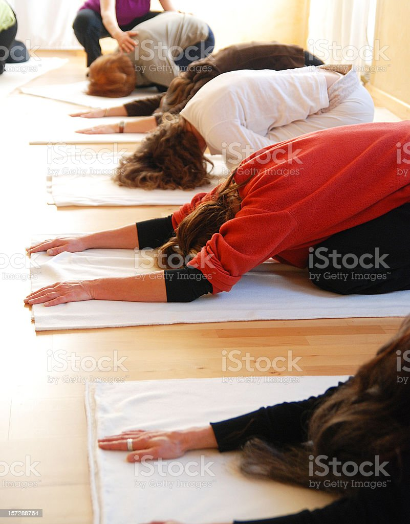 german causacian yogagroup in a row with coaching teacher stock photo