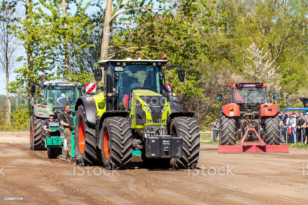 german claas axion tractor drives on track stock photo